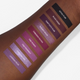 purple liquid lipstick swatches on dark skin