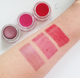 swatches of Aromi lip tints vegan + cruelty-free