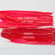 red hibiscus and poppy cherry-colored lip products vegan + cruelty-free