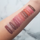 Peachy, nude, and brown liquid lipstick swatches