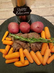 Old Fashioned Pot Roast - Slow cooked pot roast topped with roasted carrots. Served with green beans, wheat rolls, desserts and fresh brewed iced tea.