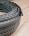 A roll of 18mm dark grey knock on edging trim for use with 15mm campervan ply pictured here on top of our driftwood ply