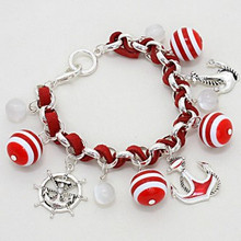 "• Style No : [231533] CB110973-AS-RD-1 1/4""H  • Color : Russian Silver / Red / Clear  • Size : 1 1/4"" H, 8"" L  • Nautical Anchor/ Helm  • Striped Weaved Sea Life Charm Bangle Bracelet  • Material : Lead and nickel compliant"