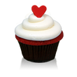 Traditional southern-style red velvet cake and cream cheese icing topped with a little red fondant heart