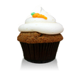 Delicious carrot cake with cream cheese icing topped with a cute frosted carrot