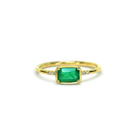 An ILA classic with an emerald cut Emerald set east-west and accented with diamond pave.  14K sustainable gold Center: 0.52ct emerald cut Emerald 0.03 tcw round diamonds, HI color/VS-SI1 clarity