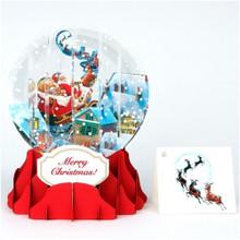 Pop-Up Christmas  Medium Snow Globe by Popshots Studios - Flying Santa Barcode:  048641535550 www.the-village-square.com