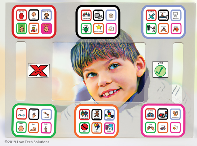 A boy using color coding on an E-TRAN board