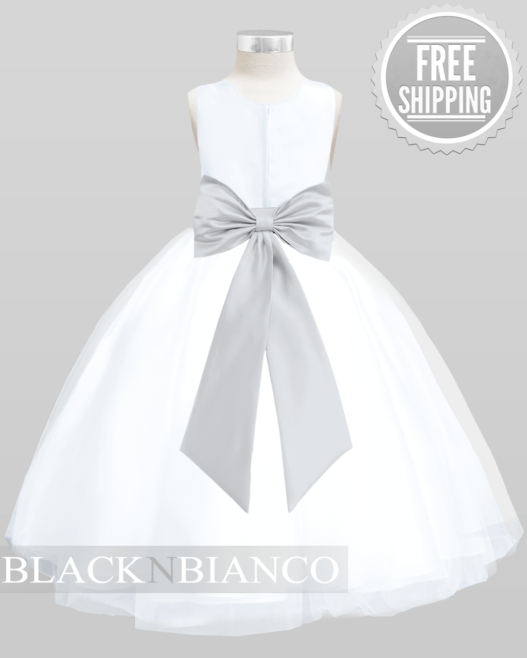 White Jr Bridemaids Dress With A Silver Colored Sash Flower And Bow