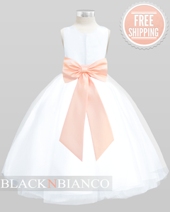 Black N Bianco white flower girl dress with a peach bow in the back