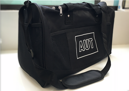 Black Duffle bag manufactured from 600D polyester with both carry handles and a shoulder strap. Has one 600D external pocket and three mesh pockets