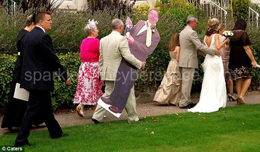 Add fun with your life sized photo cutouts of the bride and groom at the wedding reception.