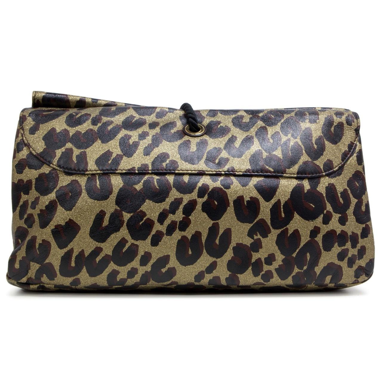 c0b88816dfd7 Louis Vuitton Leopard Nocturne African Queen Clutch - modaselle