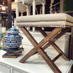 Cream Ottoman with X-Base and Studded Detailing