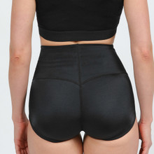 The booster   The Tummy Tucker Panty flattens the stomach and redistributes buttocks, creating a flattering appearance. Its stunning high waist design smooths the abdomen while providing support for the lower back.  OUR RESHAPING SOLUTION WHEN WORN  Lifts and holds buttocks up in position Flattens and controls the abdomen Corrects posture