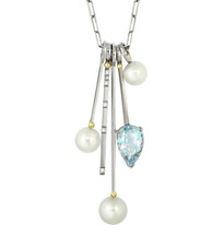 Lauren Chisholm fine art jewelry.  Stack Charm Necklace featuring five individual charms.  14k white gold,  Freshwater Pearls, Diamonds, pear cut Blue Topaz, with the designer's signature 18k gold ball detail