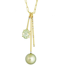 Lauren Chisholm This unique Stack Charm Necklace is composed of three individual charms, intently stacked on the chain to offer an engaging overall composition.  The Charms featured here include a luminous Pistachio Tahitian Pearl, VS GH hand set Diamonds and an oval cut Prasiolite Each Charm is solid 14k gold with the designer's signature 18k gold ball detail.  Charms can be purchased individually too.
