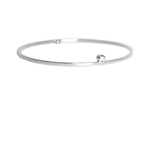 Lauren Chisholm designer jewelry, bangle bracelet, 14k white gold, 18k gold detail with a single bezel set gemstone