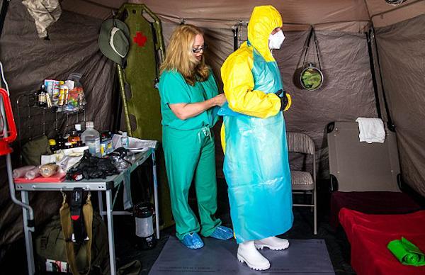 joe-and-amy-biohazard-suit-donning.jpg