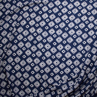 White Southwestern Medallions on Navy Blue Rayon Challis Fabric By The Yard - Wide shot