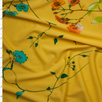 Bright Orange, Teal, and Lime Flowers and Branches on Yellow Lightweight Poly Knit Fabric By The Yard