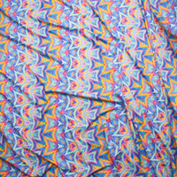 Yellow, Blue, and Violet Kaleidoscope Spandex Print Fabric By The Yard - Wide shot