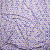 White, Light Blue, and Yellow Mini Daisy Floral on Lavender Rayon Challis Fabric By The Yard - Wide shot