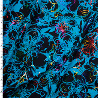 Turquoise and black spiral flowers with rainbow metallic spiral flower overlay Fabric By The Yard