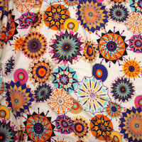Bright Bursts on Ivory Poly Peachskin Fabric By The Yard - Wide shot