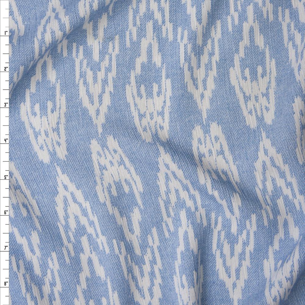 White Ikat Diamonds on Light Blue Denim Like Texture Rayon Gauze Fabric By The Yard