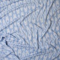 White Ikat Diamonds on Light Blue Denim Like Texture Rayon Gauze Fabric By The Yard - Wide shot
