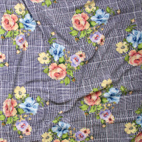 Peach, Yellow, and Light Blue Floral Clusters on Black and White Houndstooth Plaid Liverpool Knit Fabric By The Yard - Wide shot