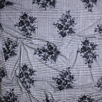 Black Floral Silhouette on Black and White Houndstooth Plaid Double Brushed Poly Spandex Fabric By The Yard - Wide shot