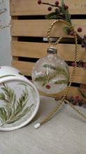 Handpainted Christmas glass ball with coordinating handpainted gift box.  Evergreen branch with colorful Christmas balls hanging in the snow....message.....love, hope, joy!