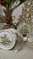 Handpainted potted Christmas tree with a tiny dove nested on a branch on glass ornament with coordinating handpainted gift box.