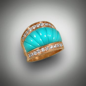 Seven pieces of Sleeping Beauty Turquoise create a wide band of color. This 14 Kt yellow gold ring is framed by twenty-two pave' set Diamonds on top and bottom (total weight 1.00 ct F/G color, VS+ clarity). Measuring almost 3/4 inch across at the top and tapering to a 1/4 inch at the back, this band is both comfortable and striking !!