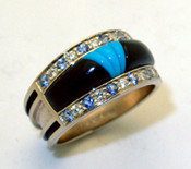 RB 3 Blue Sapphire, Diamond, Black jade, and Turquoise set into 14 kt white gold.