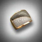 R 996 features a warm gray Jasper complimented by a full 1.00 carat of pave' set fine white Diamonds.