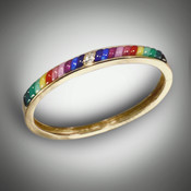 Multi-colored bracelet using natural color minerals from around the world with three Diamonds in the center, sculpted lapis, lavulite, coral, and malachite set in 14 kt yellow gold.