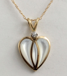Small, sweet, and sophisticated, this lovely heart features a .05 ct Round Diamond and three sculpted pieces of Mother of Pearl.  Your choice of color and Diamond size.  Mother of pearl with a 1/4 ct Diamond for your 25th anniversary....or Birthday? We can customize to suit you.