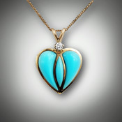 Pnd 176 heart features a .05 ct Round Diamond and three sculpted pieces of Turquoise.  You can change the diamond size or change the inlay stones to Mother of Pearl, or black jade.