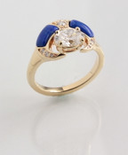 R558 ring with a 7 x5mm oval renzite with hand carved lapis inlay and 10pts pave` diamonds set in 14kt yellow gold.
