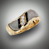 R 98-711 has hand carved grey jasper and black jade with 3 F/VS pave` diamonds set in 14kt yellow gold.