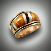 RB 1 has hand carved tiger eye stones with mother of pearl and black jade and 8 gold dividers all set in 14kt yellow gold.