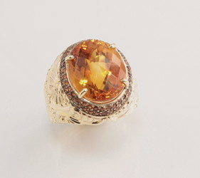 R 1178 has a 16mm oval Citrine with checkerboard face set with two rows of yellow sapphires in 14 kt yellow gold.  Weight 17 grams.