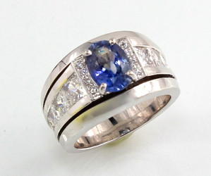 Customized R-644 with oval sapphire and princess cut stones set in 14kt white gold.