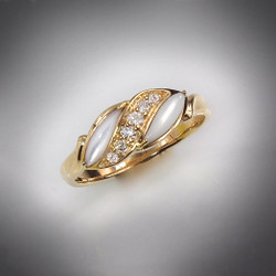 R-193 sweetheart ring with hand carved mother of pearl and .12twt F/VS pave` diamonds set in 14kt yellow gold.