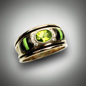 R689 Men's ring has a 8mm peridot center stone surrounded by 8 round F color VS clarity pave` diamonds with 4 hand carved pieces of black jade and 2 pieces of gaspeite as inlay set in 14kt yellow gold.
