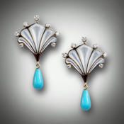 ER-211 earrings are set in 14 kt yellow gold with mother of pearl inlay with 40 points of F color VS clarity pave diamonds with a tear drop of turquoise.