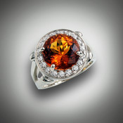 R-1069 has a 11mm amber citrine with 0.54ctw F/VS pave` diamond halo, and the sides of the halo have 0.45ctw pave diamonds set in 14kt white gold.